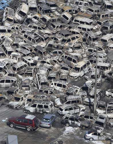 In this photo taken Friday, March 11, 2011, an aerial view shows vehicles washed away by an earthquake triggered tsunami in Hitachinaka, Ibaraki prefecture, Japan. The country&#39;s biggest recorded earthquake slammed into its eastern coast Friday. <span class=meta>( &#40;AP Photo&#47;The Yomiuri Shimbun, Atsushi Taketazu&#41;)</span>